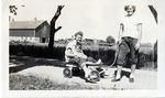 1946 - Betty Luna in a Wagon by Jean Anna Faut, Betty Luna, and Joyce Hill