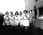 "1945 - Pauline ""Pinky"" Pirok, Nalda Bird, Anne Surkowski, Gertrude Ganote and Betty Luna at Benix Field by Elizabeth Mahon, Pauline Pinky Pirok, Nalda Bird, Anne Surkowski, Gertrude Ganote, and Betty Luna"