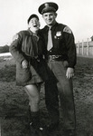 1940s, circa. - Jean Faut with Officer Kowalski Before a Game by Jean Anna Faut and Kowalski