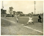 1946 - Jean Faut beats out a bunt on Opening Day at Fort Wayne by Jean Anna Faut, Fort Wayne Daisies, and Memorial Park