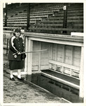 1948 circa - Jean Faut fishing in dugout by Jean Anna Faut and South Bend Blue Sox