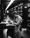 Student Reading in the Stacks ca. 1960