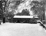 Little Chapel in snow with Mrs. D.B. Johnson's House in Background ca 1948