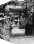 Side porch of Margaret Nance Hall through pergola ca. 1920s