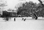 Margaret Nance in snow from Front Campus ca. late 1950s