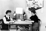 Two students at desk in their room in Margaret Nance Hall ca. late 1950s