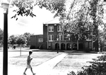 Student Walking by Peabody Gymnasium 1965 by Winthrop University