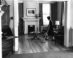 Home Management Student Vacuuming ca. 1962 by Winthrop University