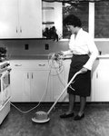 Home Management Student Buffing the Kitchen Floor ca. 1962 by Winthrop University
