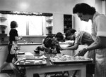 Home Management Students Preparing for Tea Serving ca. 1962 by Winthrop University