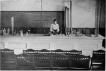 Student performing experiment ca. 1915 by Winthrop University